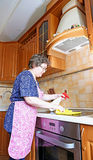 Woman housewife cleans the hob cooker Stock Images