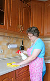 Woman housewife cleans the tabletop Stock Image