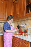 Woman housewife engaged in canning vegetables Royalty Free Stock Photos