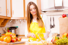 Woman housewife in kitchen cutting apple fruits Royalty Free Stock Photos