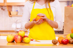 Woman housewife in kitchen with many fruits Royalty Free Stock Photo