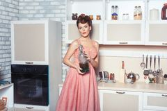 Woman housewife in the kitchen. Stock Photography