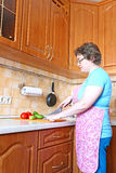 Woman housewife with a knife cut vegetables Stock Photo