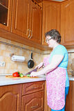 Woman housewife with a knife cut vegetables Stock Photos