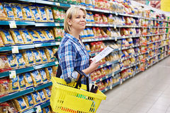 Woman housewife with list shopping in supermarket Royalty Free Stock Photos