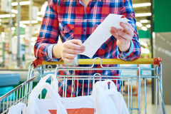 Woman housewife looking check in store Royalty Free Stock Photos