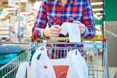 Woman housewife looking check in store Stock Images