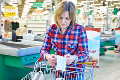 Woman housewife looking check in store Stock Photography