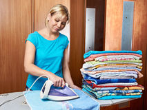 Woman housewife near ironing board Royalty Free Stock Photos