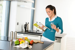 Woman housewife reading cooking book recipe kitchen Stock Photo
