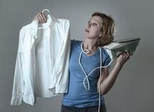Woman or housewife sad bored and stressed holding white shirt an Royalty Free Stock Image