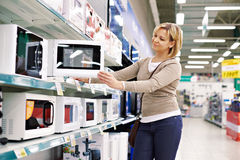 Woman housewife shopping for microwave oven Stock Image