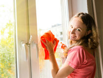 Woman housewife washes a window Stock Photos