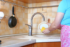 Woman housewife washing dishes Stock Photos