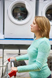 Woman housewife whit shopping cart shopping for washing machine Royalty Free Stock Photography