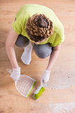 Woman during housework. Photo of woman with gloves and dustpan during housework Royalty Free Stock Images