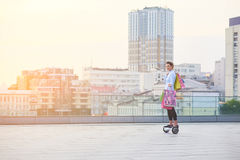 Woman on hoverboard, shopping bags. Stock Image