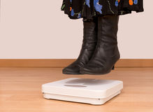 Woman hovers, floats above scales - lose weight, weightloss conc Stock Photo