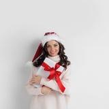 Woman hug Christmas gift Royalty Free Stock Images