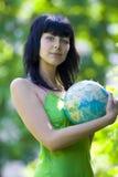 Woman hug global Royalty Free Stock Photography