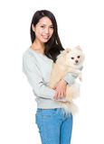 Woman hug with her lovely dog. Isolated on white background Stock Photo