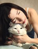 Woman hug siberian cat for relaxation Stock Image