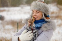 Woman hug warming her little dog in winter royalty free stock photos