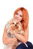 Woman hug a yorkshire terrier puppy Stock Images