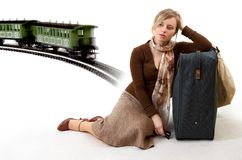 Woman with huge bag. Woman with huge suitcase is waiting for train Royalty Free Stock Photo