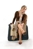 Woman with huge bag. Beauty woman with huge bag is standing on station, separate on white Stock Photography