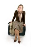 Woman with huge bag. Beauty woman with huge bag is standing on station, separate on white Royalty Free Stock Image