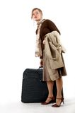 Woman with huge bag. Beauty woman with huge bag is standing on station, separate on white Stock Image