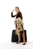 Woman with huge bag. Beauty woman with huge bag is standing on station, separate on white Stock Photos