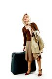 Woman with huge bag. Beauty woman with huge bag is standing on station, separate on white Royalty Free Stock Photography