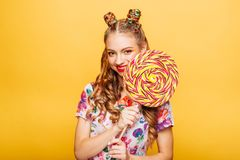 Woman with huge candy instead of a head Stock Photo