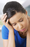 Woman with huge head ache Royalty Free Stock Photo