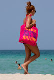Woman with huge pink Bag surf style in miami beach Stock Images