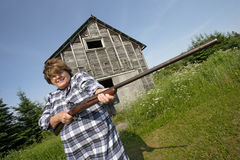 Woman with huge rifle Royalty Free Stock Photo