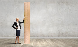 Woman with huge ruler Royalty Free Stock Photo