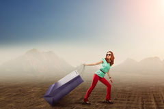 Woman with a huge shopping bag Royalty Free Stock Image