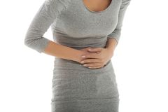 Woman with huge stomachache Stock Images