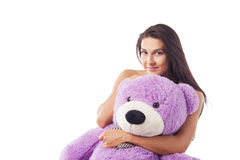 Woman with a huge teddy bear Royalty Free Stock Photography