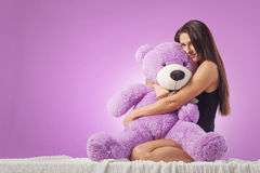 Woman with a huge teddy bear Stock Photography