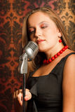 Woman hugged hand vintage microphone Royalty Free Stock Images
