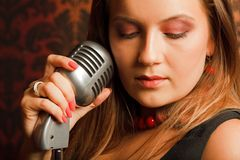 Woman hugged hand vintage microphone Royalty Free Stock Image