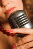 Woman hugged hand vintage microphone Stock Photos