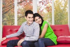 Woman huggin her boyfriend Stock Image
