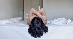 A woman hugging on the bed. Woman hugging on the bed Royalty Free Stock Photography