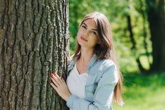 Woman hugging a big tree Stock Photos