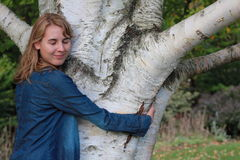 Woman Hugging Birch Tree Royalty Free Stock Images